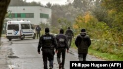 "FRANCE -- Policemen spread around the ""Centre Zahra France"" religious association in Grande Synthe during an operation of ""terrorism prevention"", near Dunkirk, October 2, 2018"