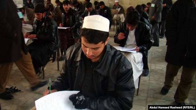 Recent graduates take university entrance exams in Kabul in 2011.