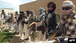 Taliban fighters pose at a mosque in Afghanistan's Ghazni Province on April 28.