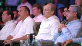 Russia - The presidents of Russia, Armenia and Azerbaijan watch a wrestling competition in Sochi, 09Aug2014.