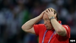 Russia's coach Leonid Slutsky reacts during a Euro 2016 preliminary round match between Russia and Slovakia