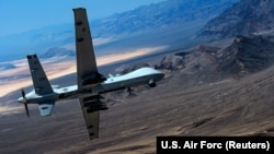 FILE: An MQ-9 Reaper remotely piloted drone aircraft performs aerial maneuvers over Creech Air Force Base in Nevada.
