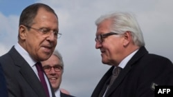 Russian Foreign Minister Sergei Lavrov (L) greets his German counterpart Frank-Walter Steinmeier just outside Volgograd on May 7.