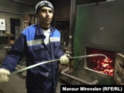 Tajik-born migrant Nazim Soliev at his job as a stoker for a school in Rozhdestveno, Russia