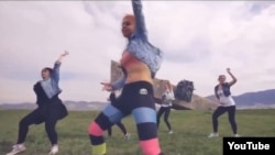 A screen grab from the music video on YouTube of six women dancing provocatively against the backdrop of a World War II memorial in Novorossiisk, Russia.