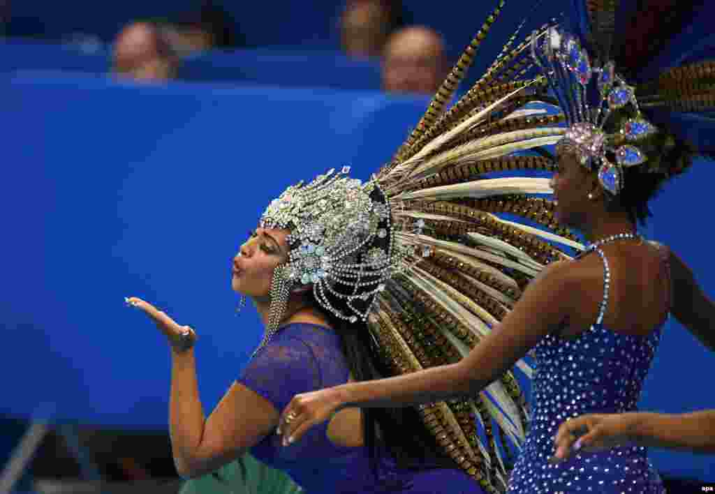 Samba dancers pose at the Olympic Aquatics Stadium in Rio.