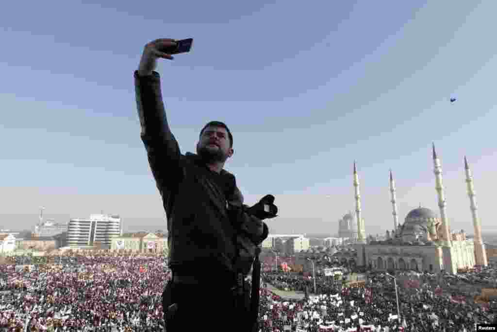 A man takes a selfie as hundreds of thousands of Chechens participated in a rally in the capital, Grozny, to protest against satirical cartoons depicting the Prophet Muhammad. (Reuters/Eduard Korniyenko)