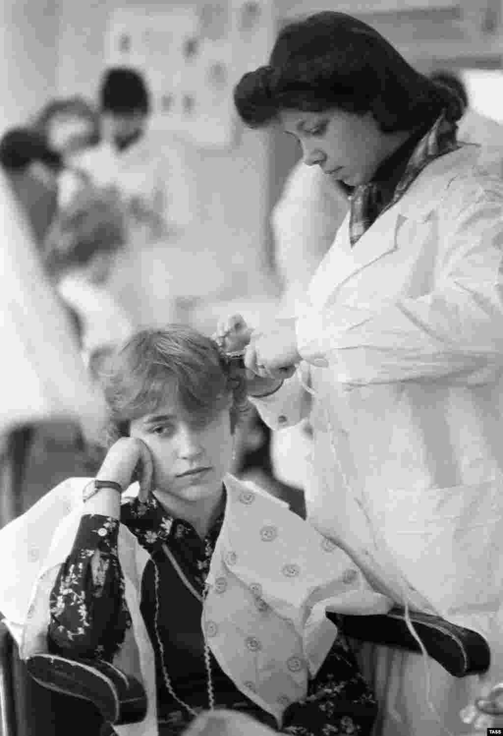 Students practice their craft at a hairdressers vocational school in 1982.