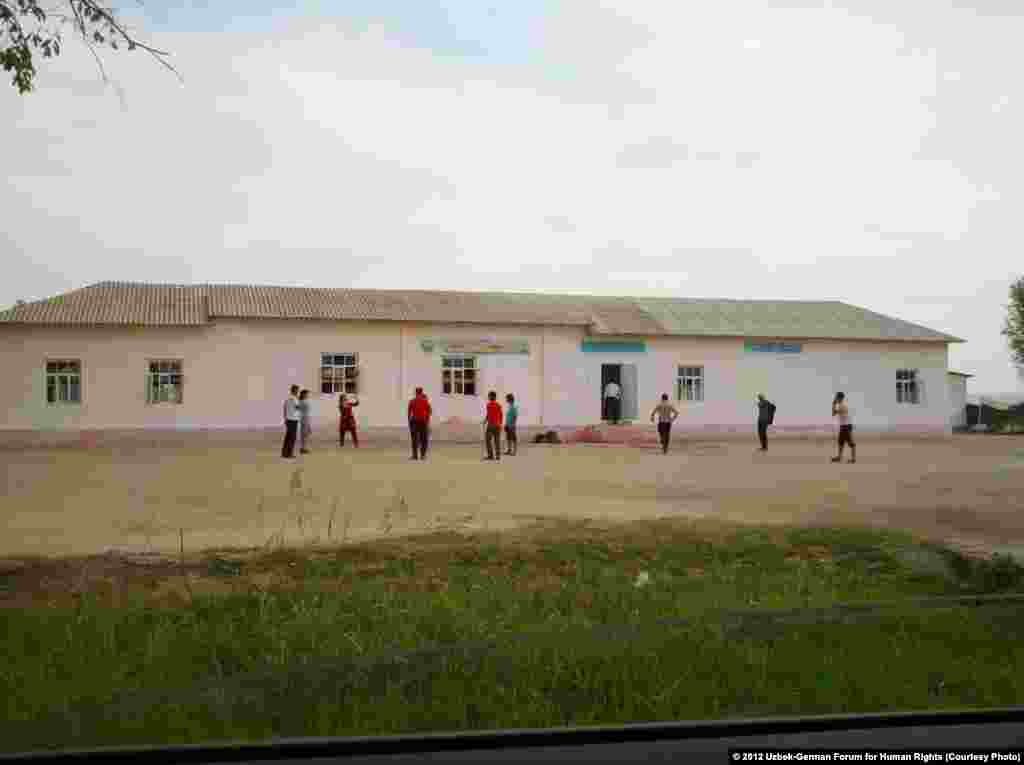 Students, ages 16 to 18, from the Transportation College of Tashkent sent to pick cotton in the Komil district of Jizzakh Province play volleyball in front of the barracks where they will stay until their quota is fully harvested. Refusing participation is not an option; students are threatened with expulsion from school.