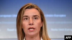 EU foreign policy chief Federica Mogherini says Iran could persuade Syria to take part in UN-led negotiations to end the country's civil war.