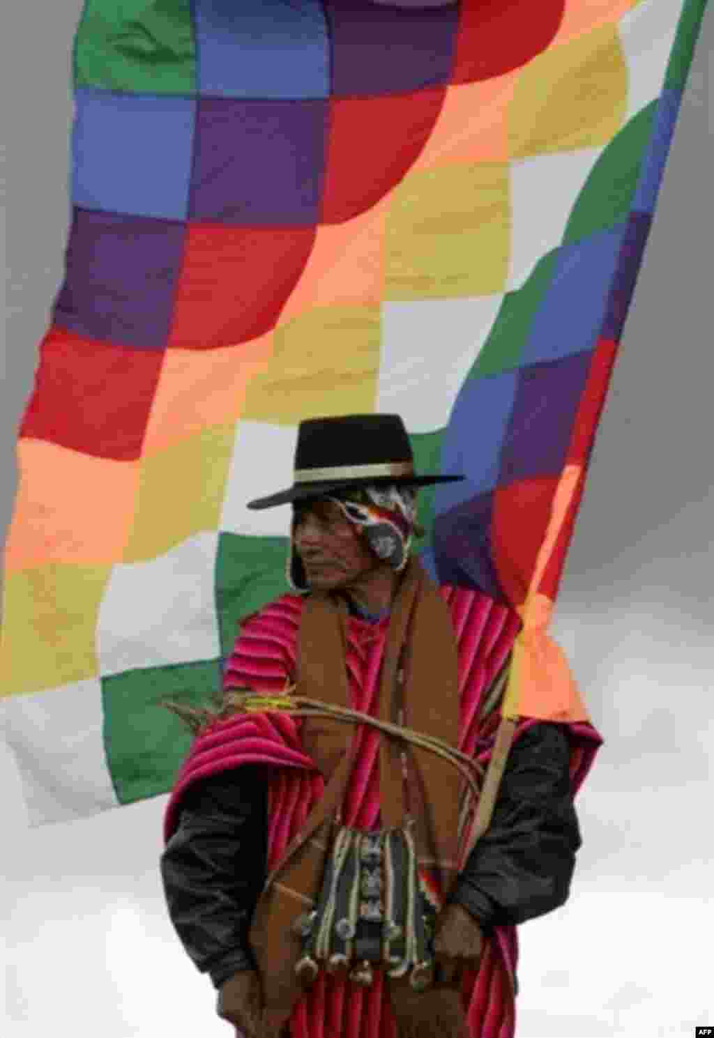 A native Bolivian holds a flag symbolizing the old Inca empire at an Indian ceremony to induct Evo Morales as Bolivia's president in January (AFP) - A tidal wave of elections -- 12 in 13 months -- moved Latin American politics leftward and placed a series of colorful, unusual, controversial, and sometimes familiar faces in presidential palaces. While some -- chiefly Venezuela's Hugo Chavez -- struck an anti-U.S. note, increased social spending and deeper regional integration were more important issues for most.