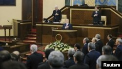 President Nursultan Nazarbaev and members of the government and parliamentarians listen to the Kazakh national anthem before the opening of the first session of the newly elected parliament in Astana in January 2012.