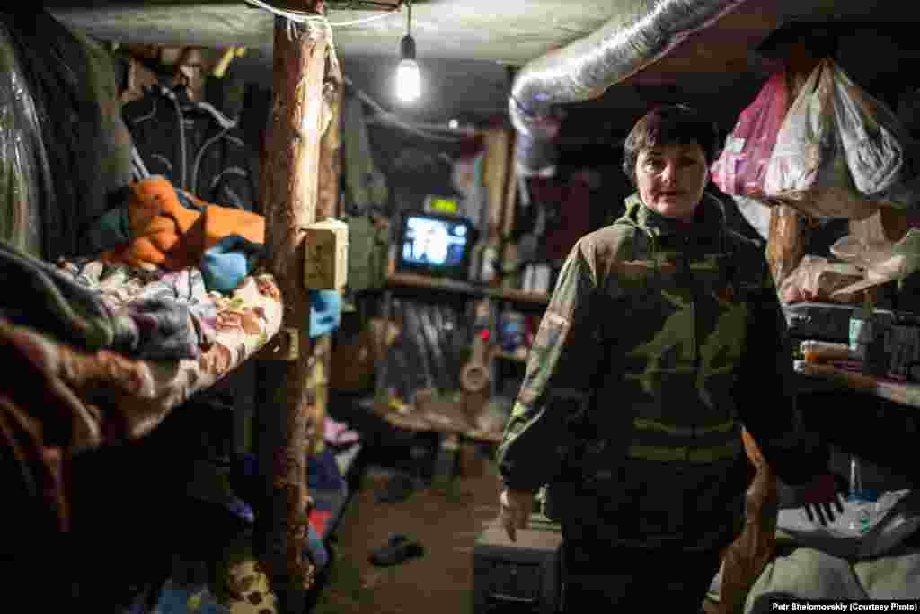 Tatiana, a nurse assisting pro-separatist fighters, inside a dugout at a rebel checkpoint in Gorlovka.
