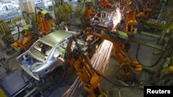 Robots work on a production line of carmaker Iran Khodro, the country's leading automobile manufacturer. (file photo)