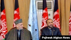 Hanif Atmar (right), with President Karzai, is seen as the answer to corruption in the Interior Ministry.