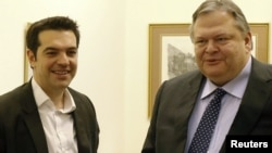 Leader of Greece's leftist Syriza bloc Alexis Tsipras (left) with the leader of the Socialist PASOK party Evangelos Venizelos after a meeting in Athens earlier this month.