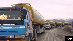 A convoy of NATO supply trucks prepare to cross into Afghanistan near the border town of Chaman in 2009.