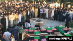Coffins of those killed in a bomb attack on a Shi'ite mosque in Herat