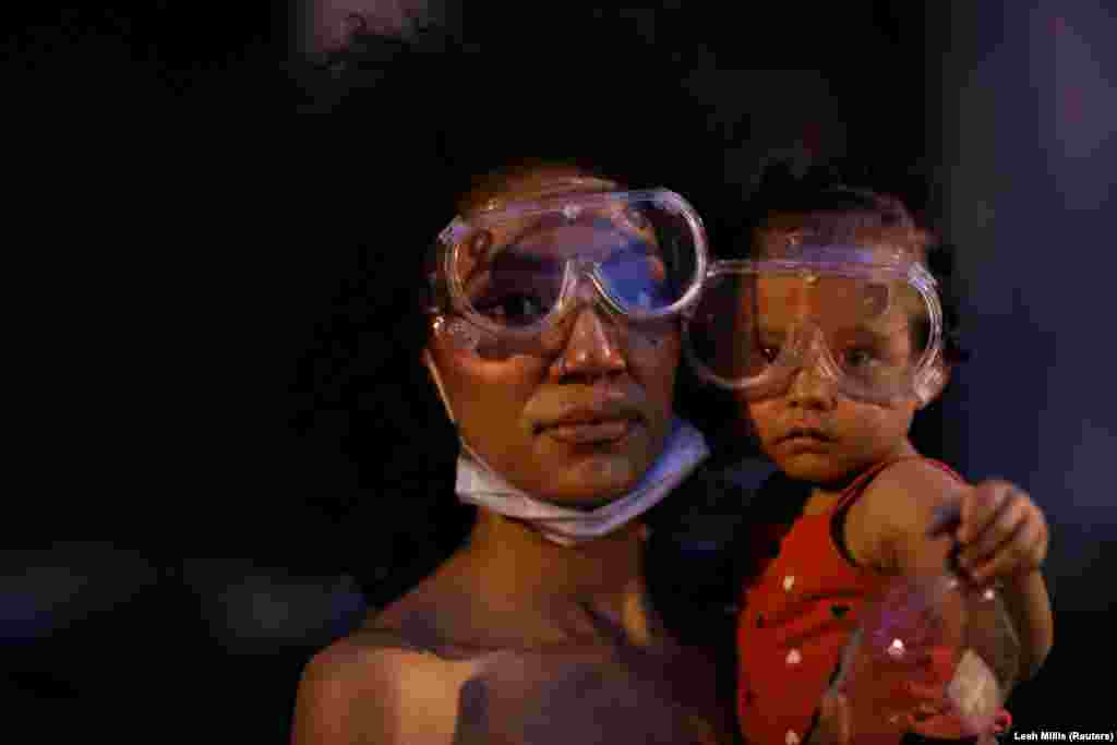 Twana and her baby Bonita pose for a portrait near the White House as racial inequality protests continue, in Washington, U.S., June 23, 2020.