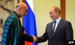 Президент Афганистана Хамид Карзай и президент России Владимир Путин.