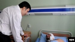 President Saakashvili visiting a patient at a military hospital in Gori on August 9