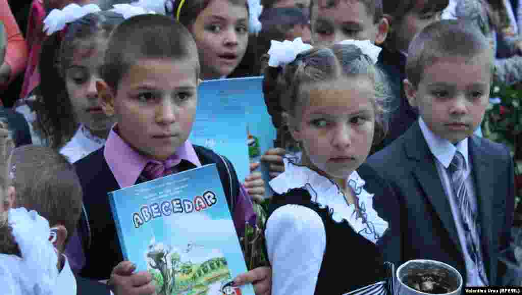 Equipped with textbooks, kids in Balanesti, Moldova, are ready to learn.