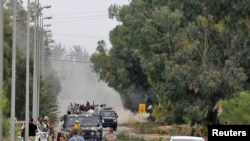 Anti-Qaddafi fighters push forward during heavy fighting towards the center of Sirte on October 7.