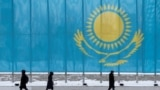 KAZAKHSTAN -- People walk past a gaint Kazakhstan's flag in Astana, March 5, 2019