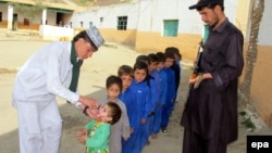 Children are vaccinated against polio during a three-day nationwide campaign to eradicate the disease, in Landikotal, near the Pakistani-Afghan border last month.
