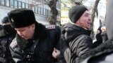 KAZAKHSTAN -- Policemen detain a man during a rally held by opposition supporters in Almaty-Nur Otan, February 27, 2019