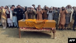Relatives and residents offer funeral prayers for victims of the Bacha Khan university attack in in Charsadda on January 21.