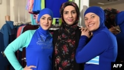 Muslim models display burkini swimsuits at a shop in Sydney.
