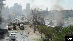Сирия -- Автомашинага коюлган бомба жардыруусунан кийин. Дамаск, 21-февраль, 2013.