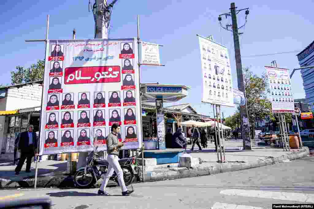 Photos of girls who get high university entry test scores are displayed on a street in Astara.