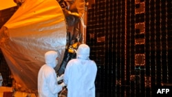 "NASA's ""Maven"" spacecraft is checked by technicians in preparation for its November 2013 launch."