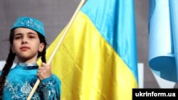 A girl in a national Crimean Tatar costume during a rally on the Day of Remembrance of the victims of the genocide of the Crimean Tatar people in Kyiv on May 18.