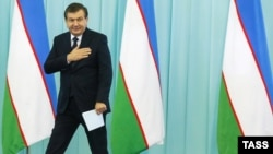 Uzbek President Shavkat Mirziyaev arrives at a rally in Tashkent earlier this month.