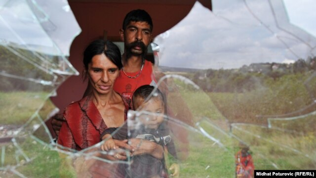"Midhat Poturovic's photograph ""Violence Against Roma People"""