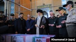 Iran's Supreme Leader Ayatollah Ali Khamenei (center) prays over the casket of Mohsen Hojaji, who was beheaded in Syria by Islamic State (IS) militants, in Tehran on September 27.