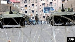 Armored vehicles patrol the streets of the Armenian capital, Yerevan, in the wake of the February 2008 presidential election.