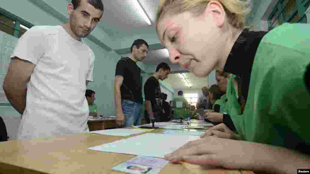 Inmates wait before receiving their ballots at a polling station in Tbilisi's Gldani Prison No. 8.