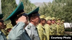 Tajik guards stand at attention during the official opening of a new Tajik-Afghan border post, which has been funded by the U.S. State Department. (courtesy of the Bureau of International Narcotics and Law Enforcement Affairs - U.S. State Dept.)