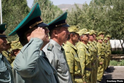 Tajik guards stand to attention during the official opening of a new border post on the Tajik-Afghan border, which has been funded by the U.S. State Department.