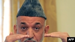 Afghan President Hamid Karzai addresses a press conference in Kabul on September 17