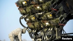A U.S. soldier inspects a Patriot missile-defense battery during joint exercises near Warsaw in 2015.