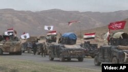 Тикрит маңында жүрген Ирак әскери техникалары.