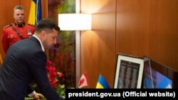 Ukrainian President Volodymyr Zelenskiy honors the victims of the tragedy at the Canadian Embassy in Kyiv.
