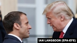 French President Emmanuel Macron (left) greets U.S. President Donald Trump (right) upon his arrival in Paris on November 10.
