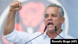 Vladimir Plahotniuc gestures as he addresses a political rally in Chisinau on June 9, 2019, just before he fled the country.