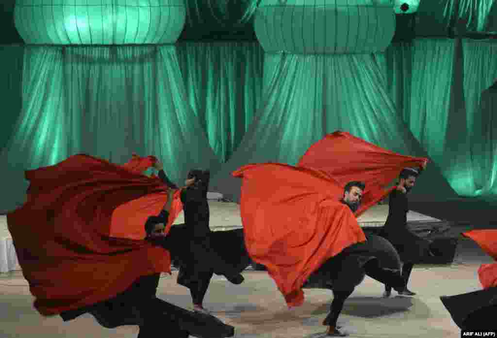 Pakistani artists perform a Sufi dance during the Mystic Music Sufi Festival in Lahore. (AFP/Arif Ali)